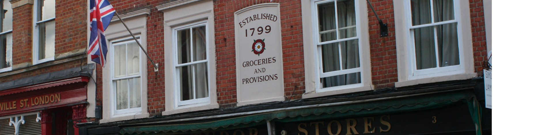 Residential flats above Grocers established in 1799 with a UK flag