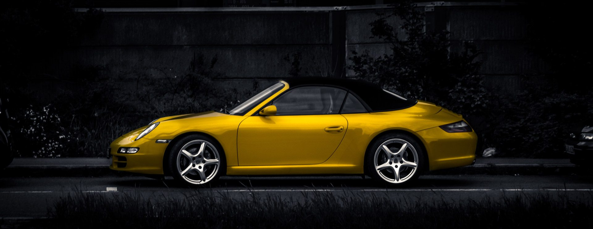 Yellow Porsche convertible needing car insurance