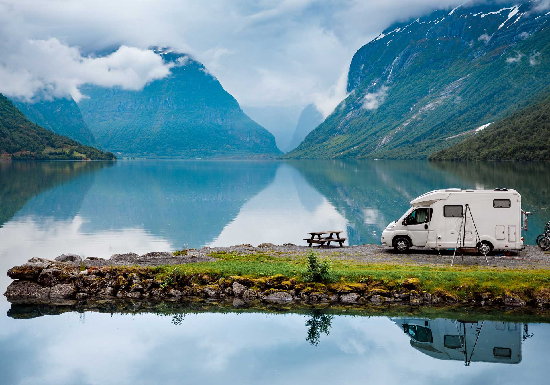 Personal caravan by a lake with mountains